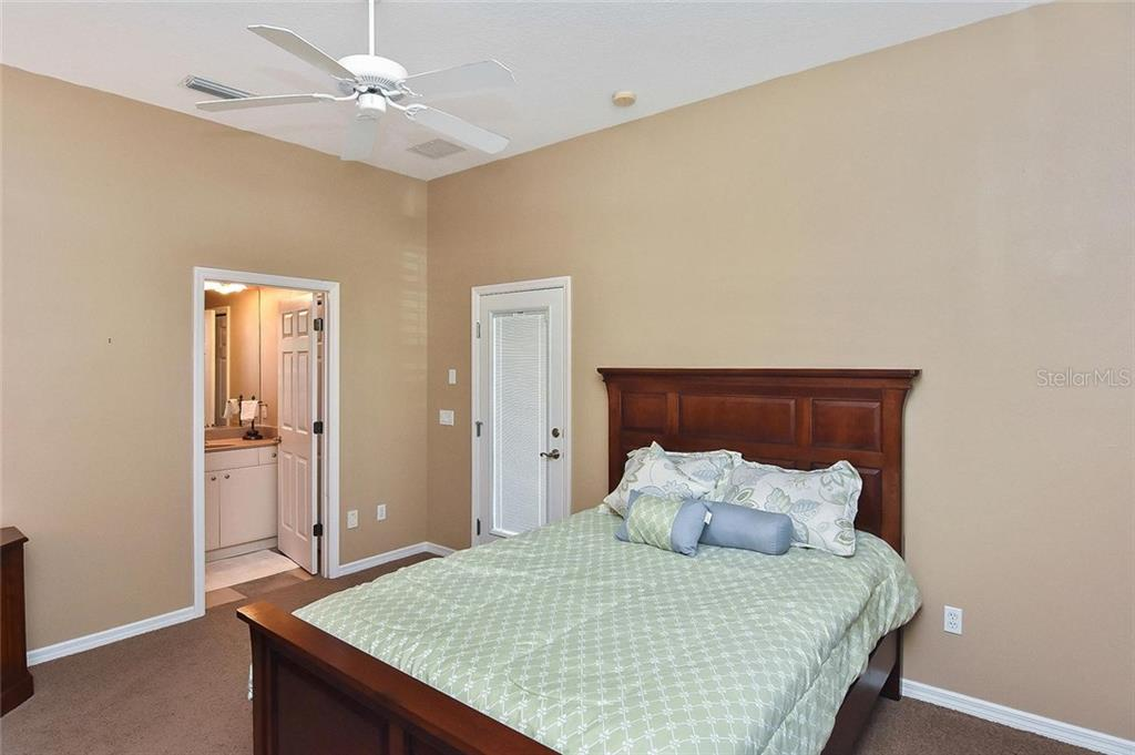 Guest house bedroom to bathroom - Single Family Home for sale at 321 Dulmer Dr, Nokomis, FL 34275 - MLS Number is N6108685