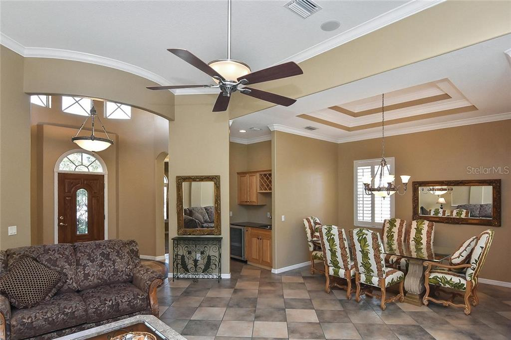 Living room, foyer, wet bar, dining room - Single Family Home for sale at 321 Dulmer Dr, Nokomis, FL 34275 - MLS Number is N6108685