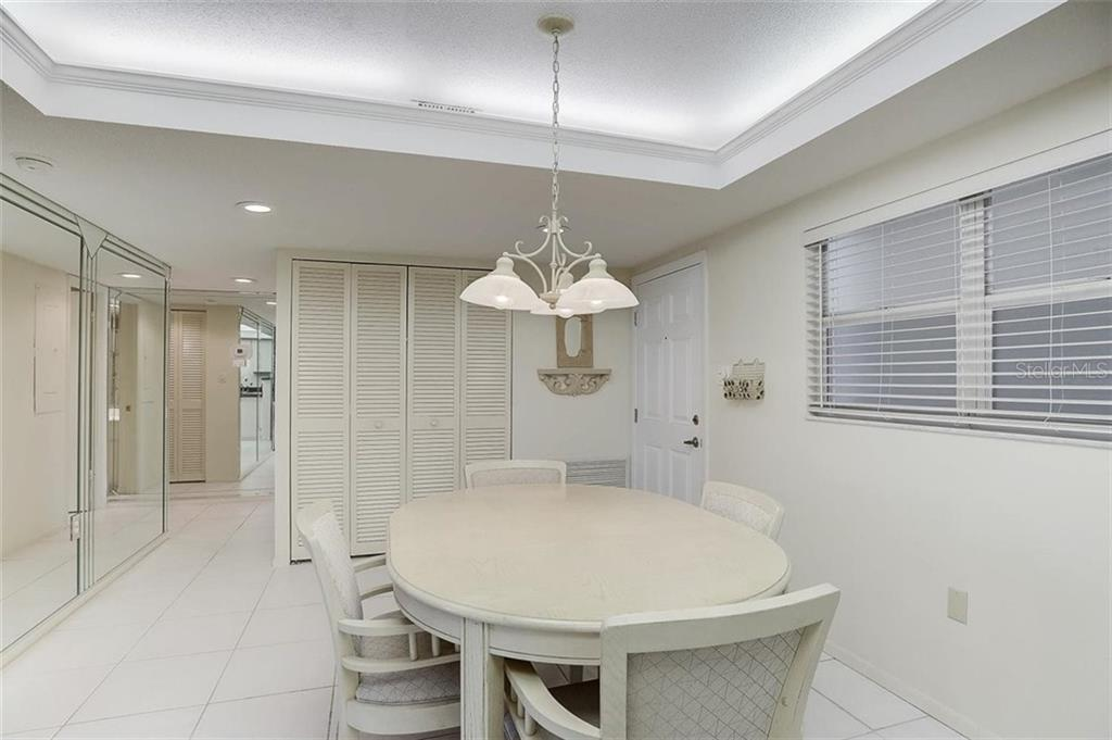 Kitchen to living room - Condo for sale at 1150 Tarpon Center Dr #203, Venice, FL 34285 - MLS Number is N6108842