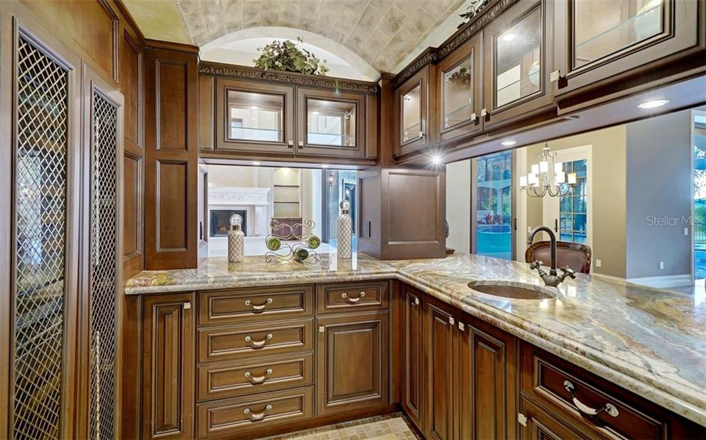 Butler's pantry, wine bar - Single Family Home for sale at 8257 Archers Ct, Sarasota, FL 34240 - MLS Number is N6109007