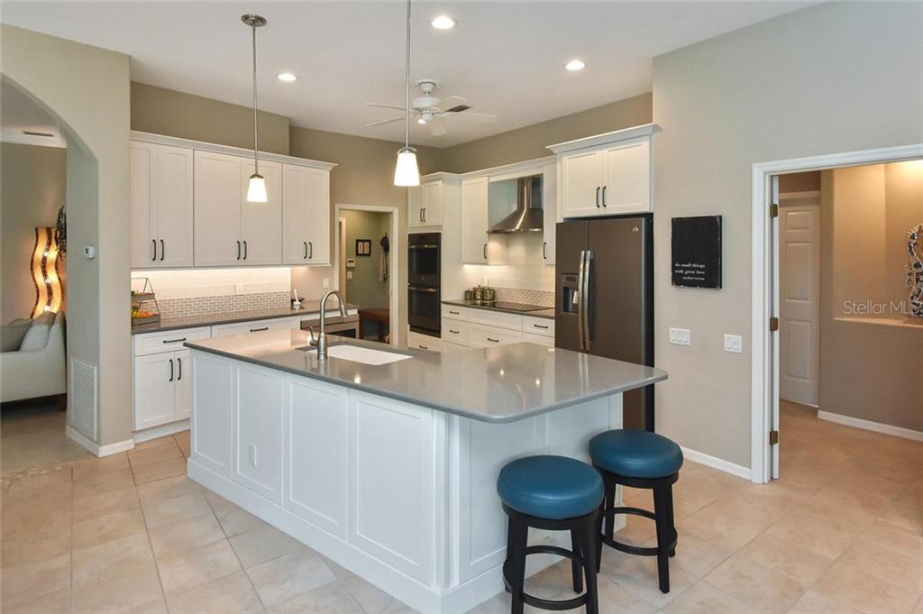 Impressive quartz counter tops - Single Family Home for sale at 7185 N Serenoa Dr, Sarasota, FL 34241 - MLS Number is N6109058