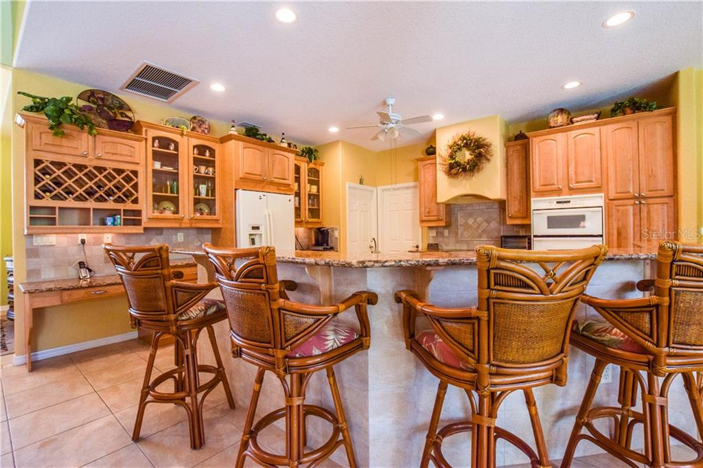 View of kitchen and breakfast bar. - Single Family Home for sale at 2560 Pebble Creek Pl, Port Charlotte, FL 33948 - MLS Number is N6109100