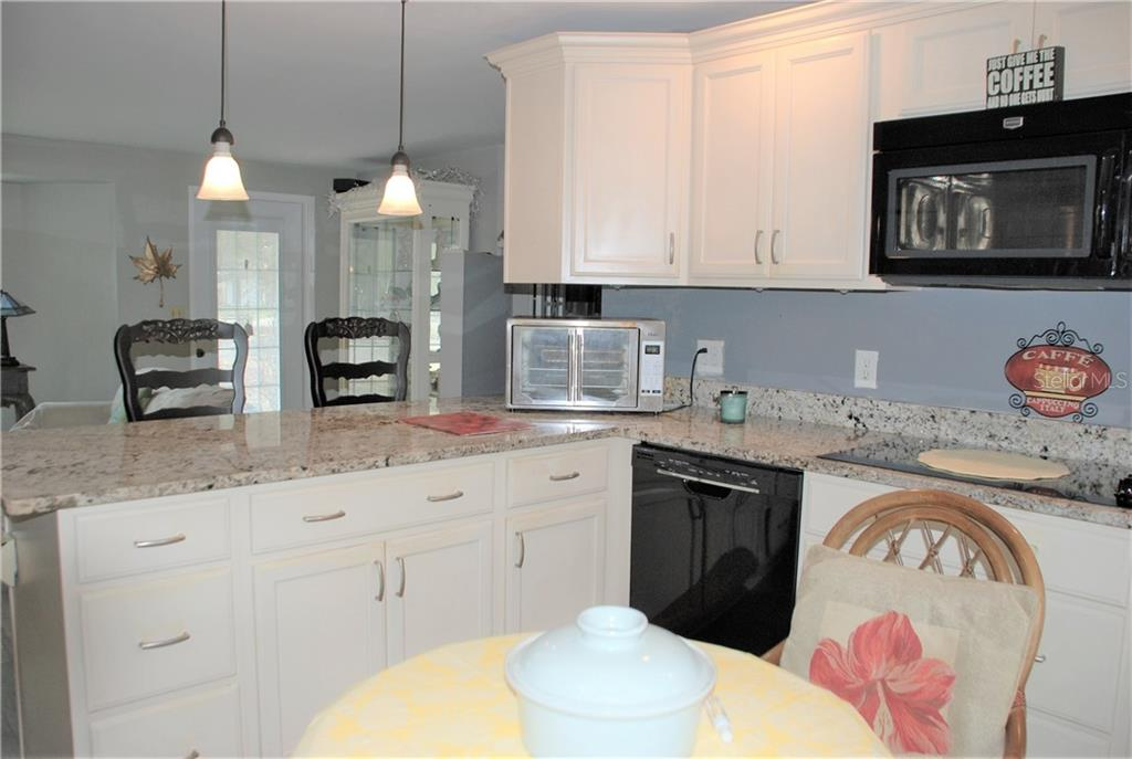 Kitchen to living room - Single Family Home for sale at 508 Nassau St S, Venice, FL 34285 - MLS Number is N6109180