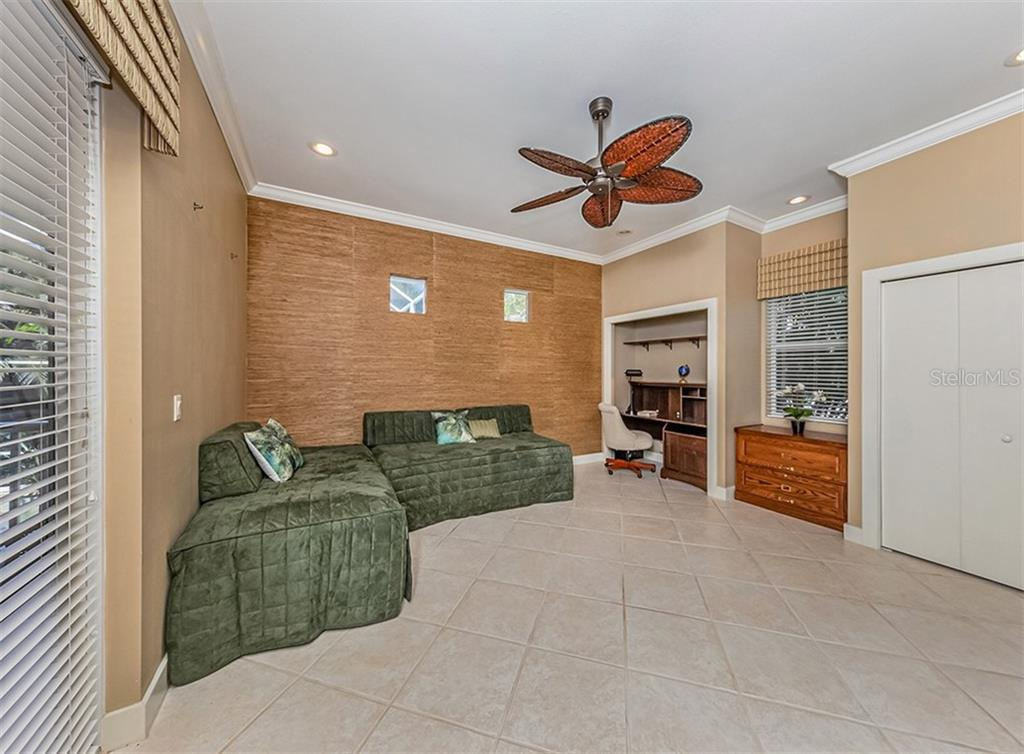 Versatile 2nd bedroom with french doors that lead out to the lanai and pool area - Single Family Home for sale at 727 Eagle Point Dr, Venice, FL 34285 - MLS Number is N6110087