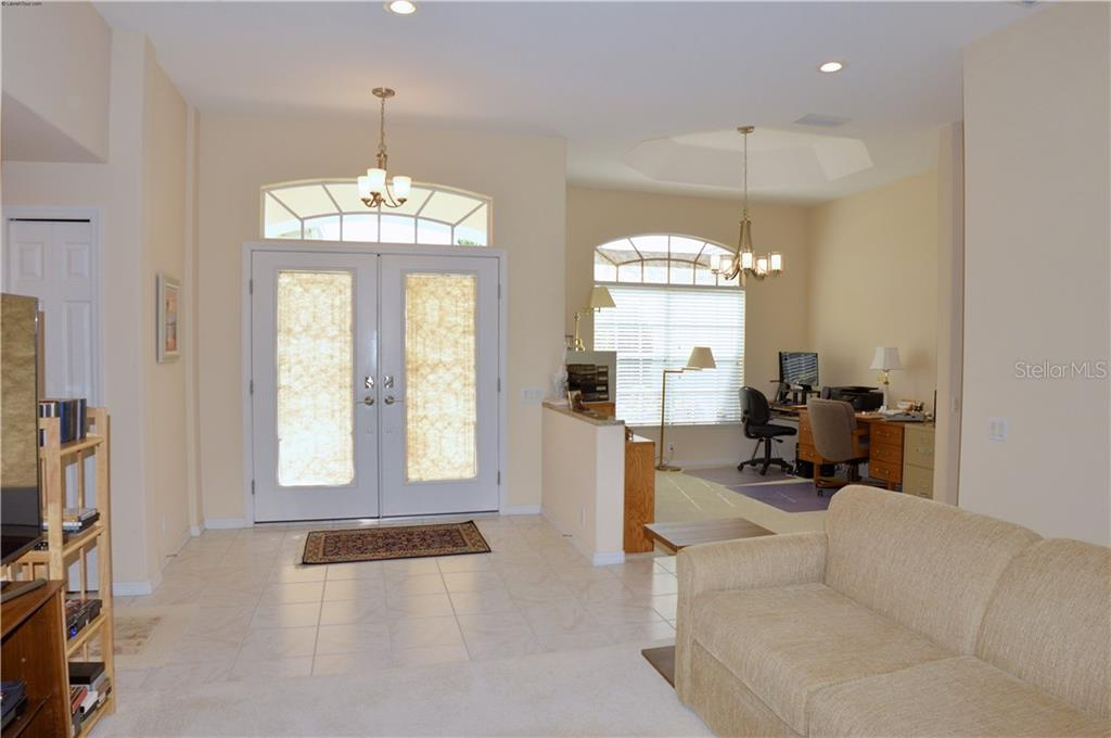 Living room, foyer, dining room - Single Family Home for sale at 413 Pebble Creek Ct, Venice, FL 34285 - MLS Number is N6110166