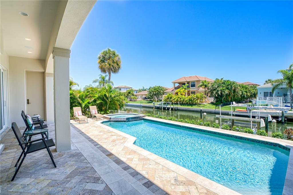 Heated Pool with covered lanai and full bathroom (see door at the end) - Single Family Home for sale at 510 Bowsprit Ln, Longboat Key, FL 34228 - MLS Number is N6110334