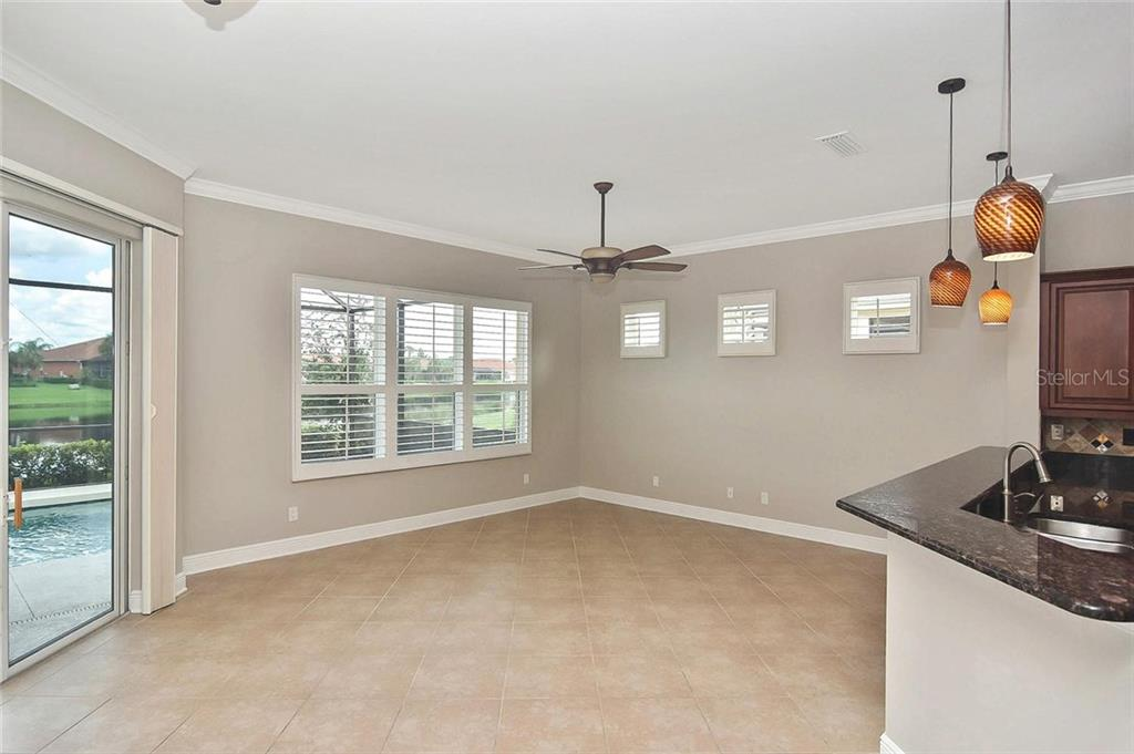 Family room, breakfast bar - Single Family Home for sale at 193 Medici Ter, North Venice, FL 34275 - MLS Number is N6110365