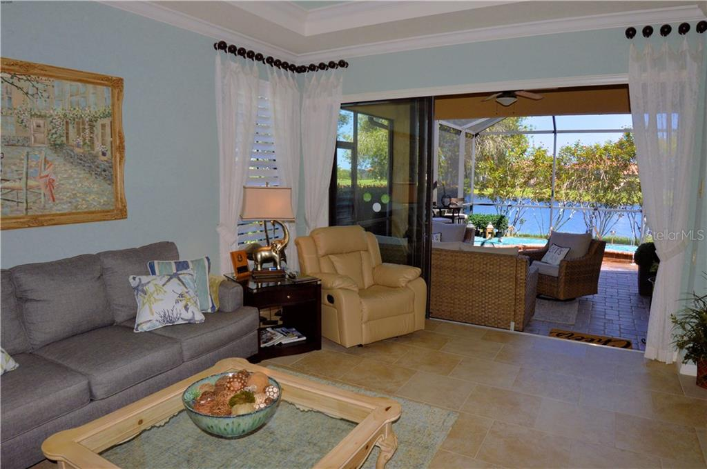 Living room with sliders to lanai - Villa for sale at 20117 Tesoro Dr, Venice, FL 34293 - MLS Number is N6111641