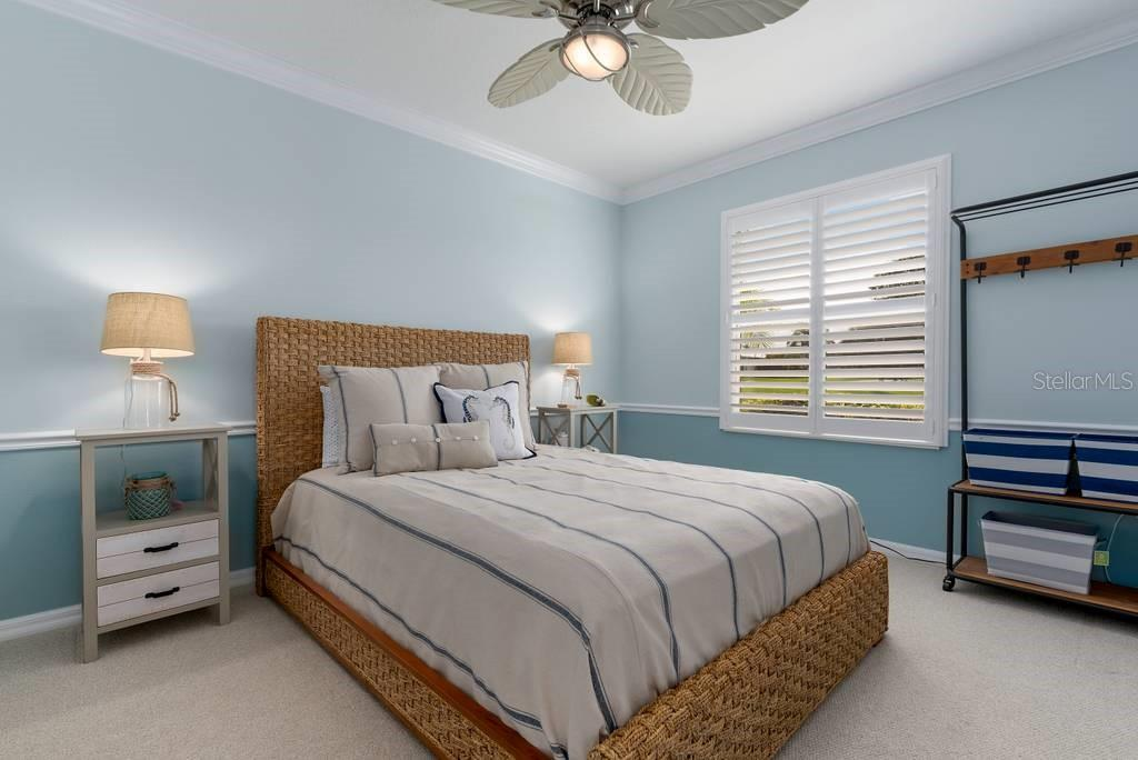 Den/office (currently used as a bedroom, but it is a real den) with Plantation shutters and crown molding - Single Family Home for sale at 601 Cockatoo Cir, Venice, FL 34285 - MLS Number is N6111658