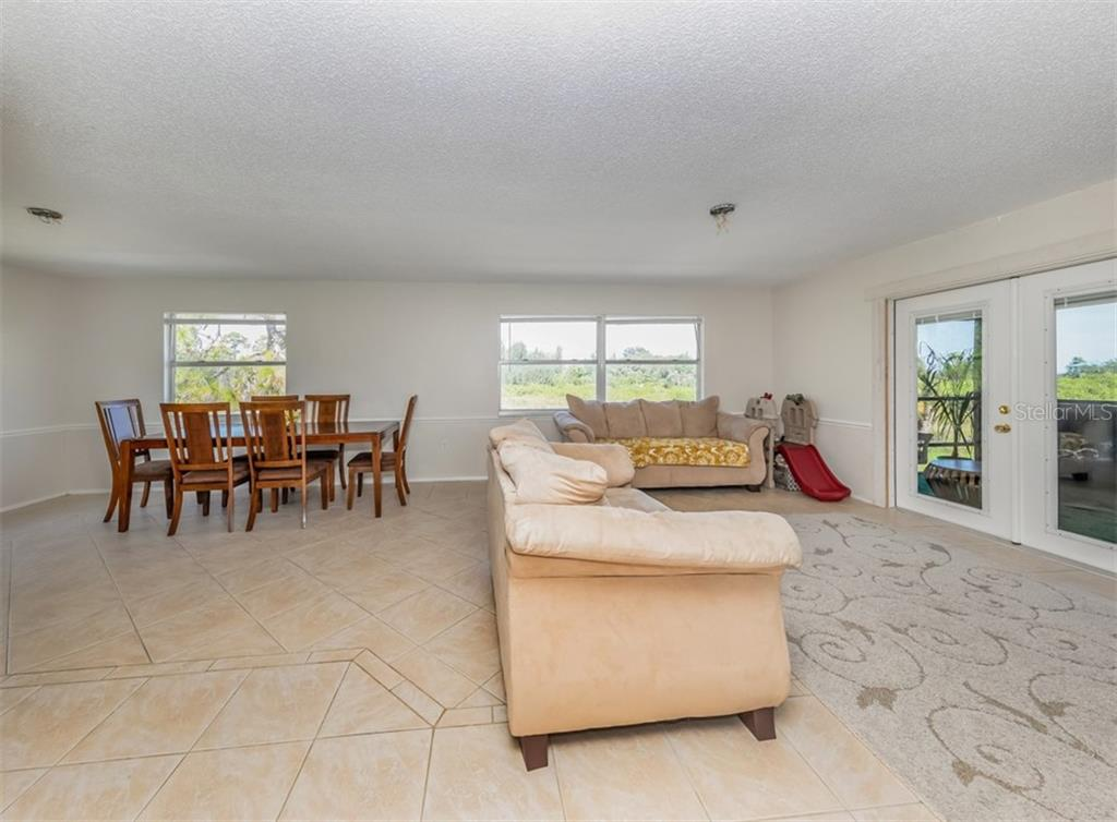 Great room, dining area - Single Family Home for sale at 9425 Myakka Dr, Venice, FL 34293 - MLS Number is N6112567