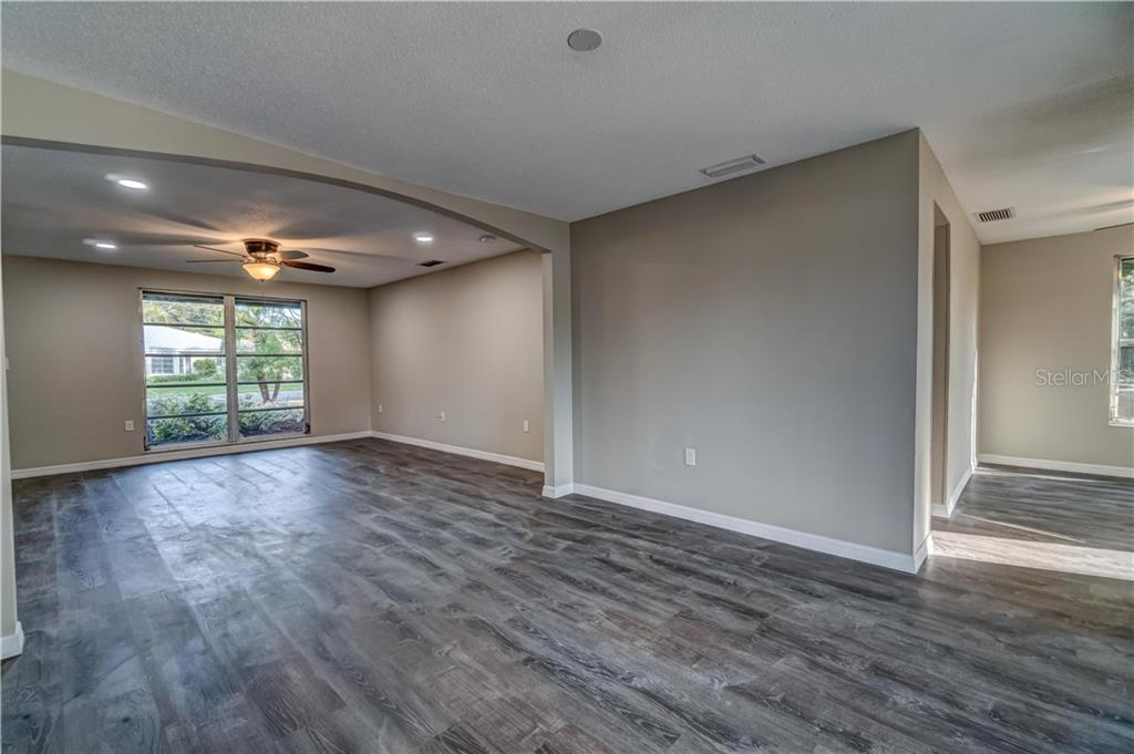 Dining, Living room with kitchen to the right - Single Family Home for sale at 607 Garden Rd, Venice, FL 34293 - MLS Number is N6113347