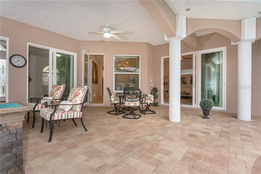 Room for plenty of outdoor dining and relaxing on the spacious covered portion of the courtyard. - Single Family Home for sale at 1670 Maria St, Englewood, FL 34223 - MLS Number is N6113779