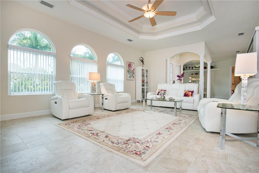 Another view of the formal living room, front entry and dining beyond. - Single Family Home for sale at 1670 Maria St, Englewood, FL 34223 - MLS Number is N6113779