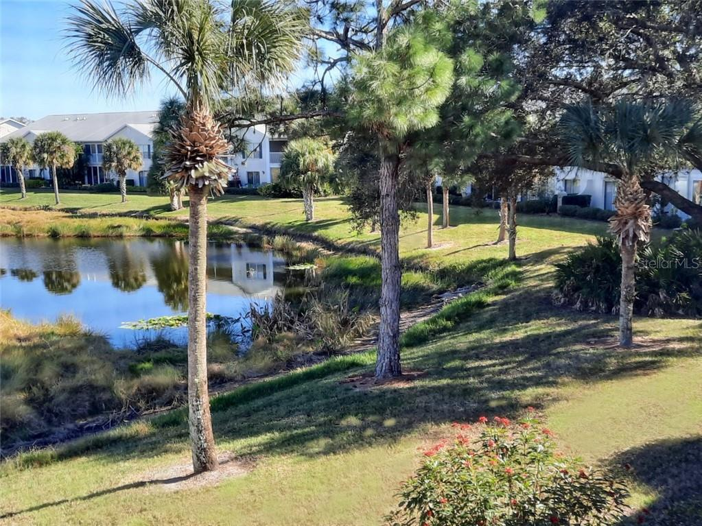 Water view from master bedroom - Condo for sale at 406 Laurel Lake Dr #203, Venice, FL 34292 - MLS Number is N6113915