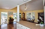 Kitchen to dining room - Single Family Home for sale at 910 Casey Cove Dr, Nokomis, FL 34275 - MLS Number is N5915385