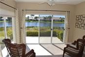Lanai with sliders to patio - Condo for sale at 903 Addington Ct #102, Venice, FL 34293 - MLS Number is N5916962