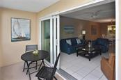 Lanai to living room - Condo for sale at 512 W Venice Ave #506, Venice, FL 34285 - MLS Number is N6100462