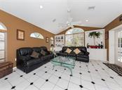 Great room features vaulted ceilings, custom shelving and French doors leading to the lanai and pool. - Single Family Home for sale at 620 Valencia Rd, Venice, FL 34285 - MLS Number is N6100912