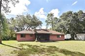 Rear exterior - Single Family Home for sale at 3572 January Ave, North Port, FL 34288 - MLS Number is N6102434