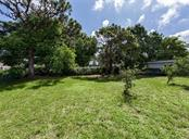 Yard - Single Family Home for sale at 717 Guild Dr, Venice, FL 34285 - MLS Number is N6103134
