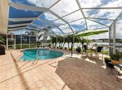 Pool, lake view - Single Family Home for sale at 627 Lakescene Dr, Venice, FL 34293 - MLS Number is N6103268