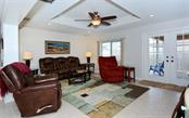 Family room - Single Family Home for sale at 1460 Strada D Argento, Venice, FL 34292 - MLS Number is N6104612