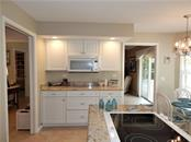 BUILT IN BUFFET WITH MICROWAVE - Villa for sale at 572 Clubside Cir #34, Venice, FL 34293 - MLS Number is N6105221