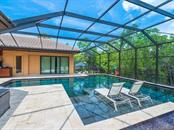 Saltwater Pool - Single Family Home for sale at 1050 Gulf Winds Way, Nokomis, FL 34275 - MLS Number is N6106314