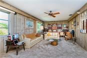 Family room with large windows - Single Family Home for sale at 359 Renoir Dr, Osprey, FL 34229 - MLS Number is N6106429