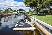 Looking down canal and seawall. - Single Family Home for sale at 2560 Pebble Creek Pl, Port Charlotte, FL 33948 - MLS Number is N6109100