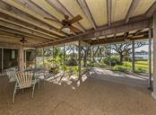 Covered and screened lanai - Single Family Home for sale at 915 Bayshore Rd, Nokomis, FL 34275 - MLS Number is N6109471