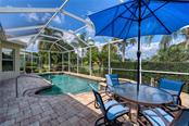 Lanai with brick pavers and Pebble Tech heated pool and spa - Single Family Home for sale at 953 Chickadee Dr, Venice, FL 34285 - MLS Number is N6111180