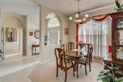 Dining room, foyer - Single Family Home for sale at 1031 Scherer Way, Osprey, FL 34229 - MLS Number is N6111839