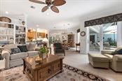 Family room to dining room and kitchen - Single Family Home for sale at 725 Eagle Point Dr, Venice, FL 34285 - MLS Number is N6111842