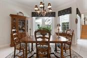 Dining area - Single Family Home for sale at 725 Eagle Point Dr, Venice, FL 34285 - MLS Number is N6111842