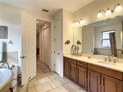 Master bathroom to master bedroom - Single Family Home for sale at 108 Maraviya Blvd, North Venice, FL 34275 - MLS Number is N6113946
