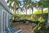 Patio outside guest house - Single Family Home for sale at 161 & 181 Gilchrist Ave, Boca Grande, FL 33921 - MLS Number is D5915030