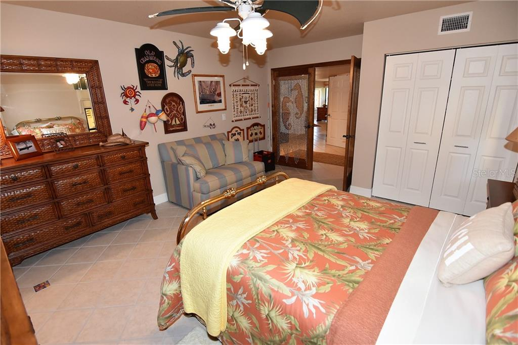 Guest bedroom shows closet space as well as the entrance through the double doors - Condo for sale at 3210 Southshore Dr #11a, Punta Gorda, FL 33955 - MLS Number is C7402449