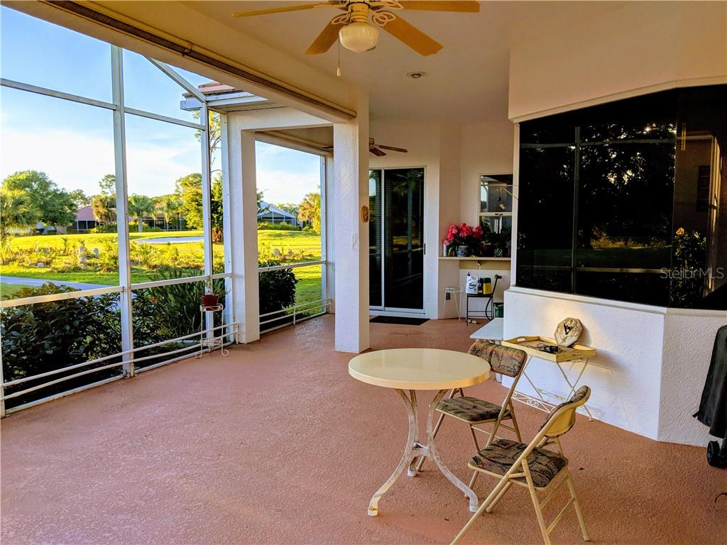 HUGE LANAI, WITH WATER AND GOLF COURSE VIEWS, SUN SHADES - Single Family Home for sale at 26442 Feathersound Dr, Punta Gorda, FL 33955 - MLS Number is C7412660