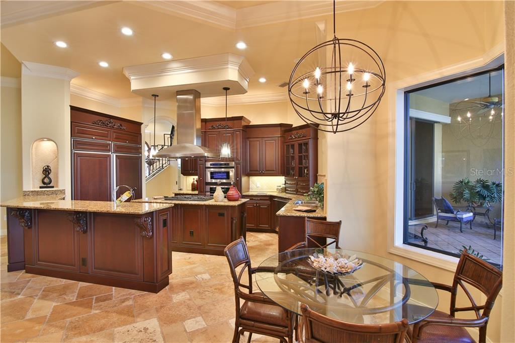 The heart of the home.  This kitchen has tremendous storage, gas cooking; center island; large walk-in pantry and aquarium window to the outdoor living. - Single Family Home for sale at 8365 Catamaran Cir, Lakewood Ranch, FL 34202 - MLS Number is A4187448
