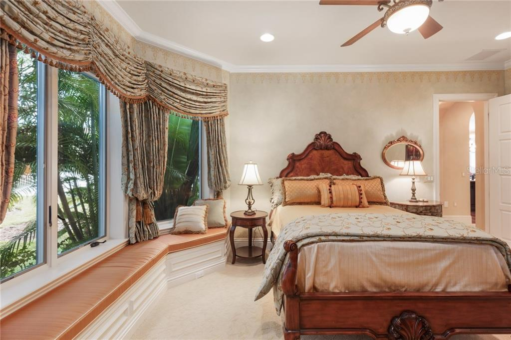 Two of three guest bedroom suites. - Single Family Home for sale at 7320 Barclay Ct, University Park, FL 34201 - MLS Number is A4200908