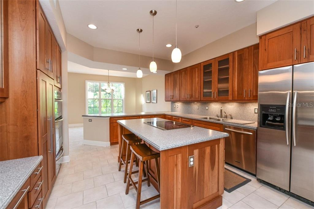 Gourmet kitchen features double ovens, island seating and convenient desk area. - Single Family Home for sale at 3947 Somerset Dr, Sarasota, FL 34242 - MLS Number is A4201541