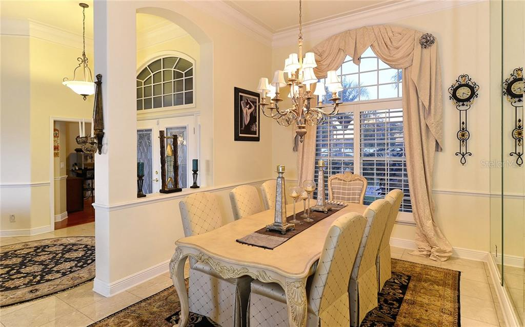 Luxurious formal dining area with high ceilings, and also views of the Intercoastal water way to enjoy while entertaining. - Single Family Home for sale at 5824 Tidewood Ave, Sarasota, FL 34231 - MLS Number is A4205461