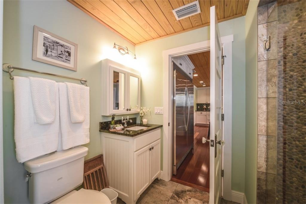 Guest bath with large walk-in pebble shower - Single Family Home for sale at 306 Gulf Blvd, Anna Maria, FL 34216 - MLS Number is A4206962