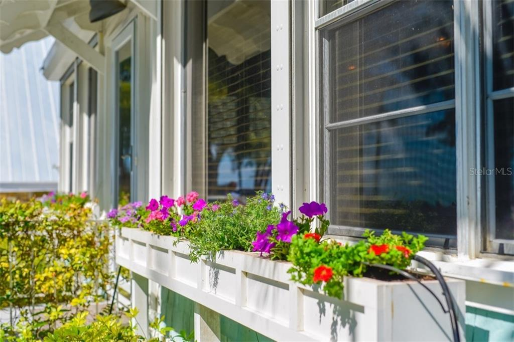 Beautiful window boxes frame this charming home. - Single Family Home for sale at 306 Gulf Blvd, Anna Maria, FL 34216 - MLS Number is A4206962