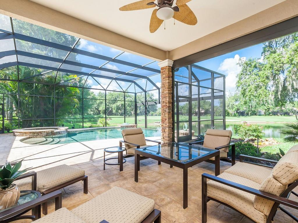 Your view from the veranda to the pool, water and golf course beyond. - Single Family Home for sale at 12312 Newcastle Pl, Lakewood Ranch, FL 34202 - MLS Number is A4403090
