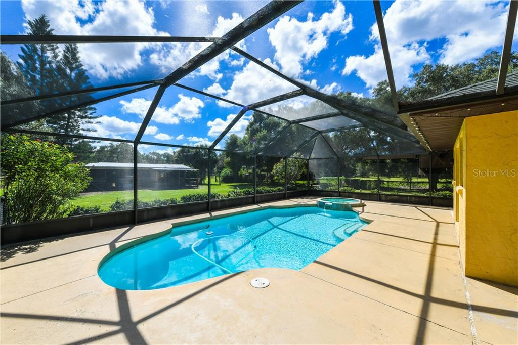 The lanai overlooks the backyard. - Single Family Home for sale at 2045 Frederick Dr, Venice, FL 34292 - MLS Number is A4416740