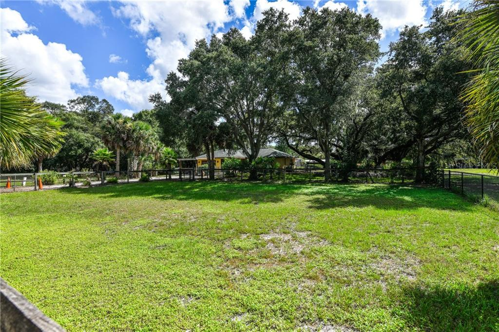 A garage and a carport. - Single Family Home for sale at 2045 Frederick Dr, Venice, FL 34292 - MLS Number is A4416740