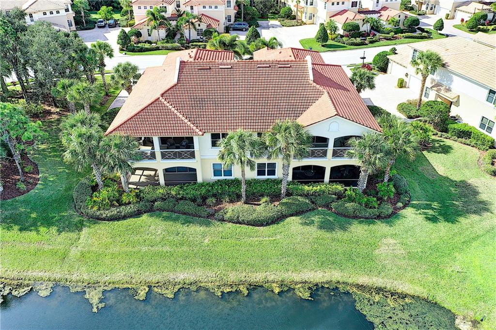 Overhead shot looking back from the pond and golf course. - Condo for sale at 9453 Discovery Ter #201c, Bradenton, FL 34212 - MLS Number is A4423314