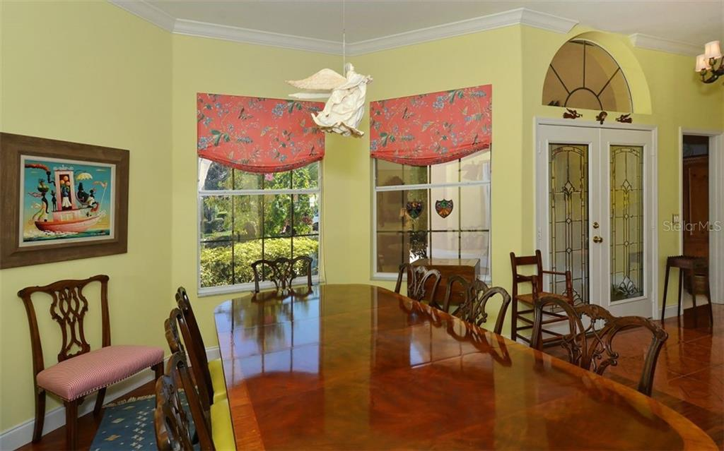 Large double windows in the spacious formal dining room. - Single Family Home for sale at 8926 Grey Oaks Ave, Sarasota, FL 34238 - MLS Number is A4425574